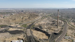 AF0001_000925 - HD stock footage aerial video flyby smoke stacks to approach I-10 in El Paso, Texas