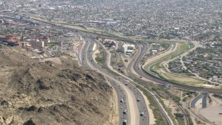 AF0001_000926 - HD stock footage aerial video flyby I-10 and rugged hillside near a densely populated area, El Paso, Texas