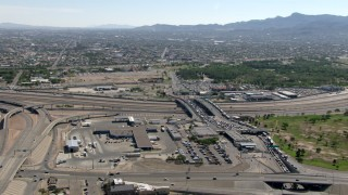 AF0001_000936 - Aerial stock footage of The Bridge of the Americas, with Ciudad Juarez in the background, El Paso/Juarez Border
