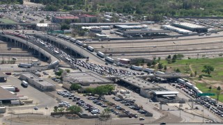 AF0001_000938 - Aerial stock footage of A view of heavy traffic at the Bridge of the Americas on the El Paso/Juarez Border