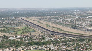 AF0001_000941 - Aerial stock footage of Highway 375 and the fence on US/Mexico border, El Paso, Texas