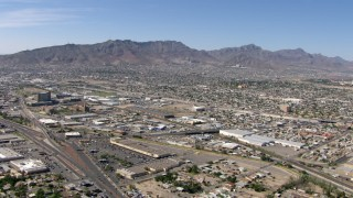 AF0001_000945 - HD stock footage aerial video of Fox Plaza shopping center, warehouse buildings, and neighborhoods near the Franklin Mountains in El Paso, Texas