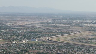 AF0001_000946 - HD stock footage aerial video of suburban neighborhoods near the fence on the US/Mexico border, El Paso, Texas