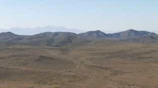 AF0001_000952 - HD stock footage aerial video of an arid plain and mountain ranges near El Paso, Texas