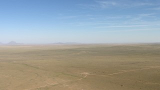 AF0001_000955 - HD stock footage aerial video flyby a wide arid plain near El Paso, Texas