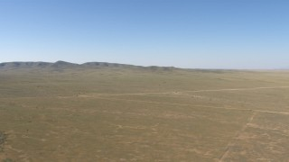 AF0001_000956 - HD stock footage aerial video of a desert plain and hills near El Paso, Texas