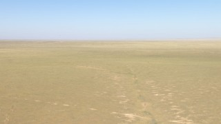 AF0001_000957 - Aerial stock footage of Flying over a wide desert plain near El Paso, Texas