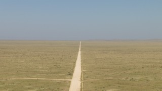 AF0001_000963 - HD stock footage aerial video of following a dirt road through a desert plain near El Paso, Texas
