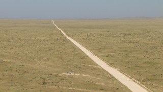AF0001_000964 - HD stock footage aerial video of passing a dirt road cutting through a desert plain, El Paso, Texas