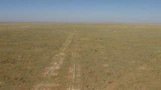 AF0001_000966 - HD stock footage aerial video of flying over an arid plain near El Paso, Texas