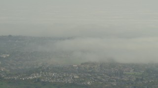 AF0001_000975 - 5K stock footage aerial video of low fog over suburban homes in Los Angeles, California