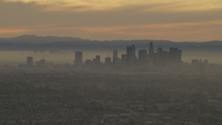 AF0001_000984 - 5K stock footage aerial video of the Downtown Los Angeles skyline at a hazy sunset, California