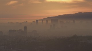 AF0001_000992 - 5K stock footage aerial video of a view of Century City skyscrapers at sunset, California