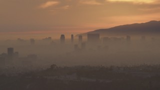 AF0001_000993 - 5K stock footage aerial video of Century City skyscrapers in haze at sunset, California