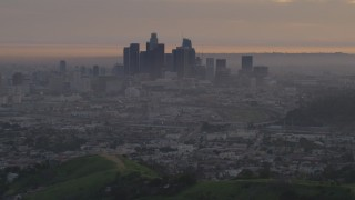 AF0001_000995 - 5K stock footage aerial video of a view west at the Downtown Los Angeles skyline at twilight, California