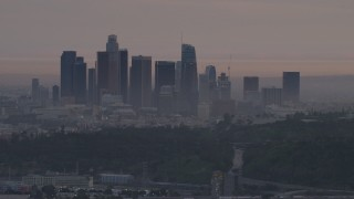 AF0001_000997 - 5K stock footage aerial video of the Downtown Los Angeles skyline seen from behind Dodger Stadium at twilight, California