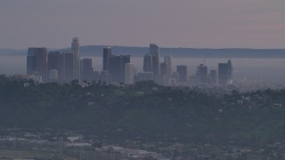AF0001_001002 - 5K stock footage aerial video of Downtown Los Angeles skyline behind hilltop Echo Park homes at twilight, California