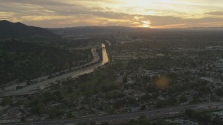 AF0001_001008 - 5K stock footage aerial video of Los Angeles River, Highway 134, and neighborhoods at sunset, Burbank, California