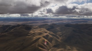 AF0001_001013 - Aerial stock footage of Clouds over desert hills in Southern California