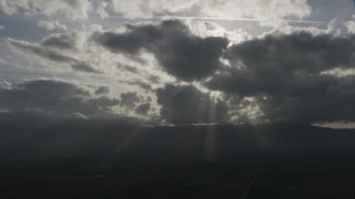 AF0001_001024 - Aerial stock footage of Clouds with godrays over farm fields in Southern California