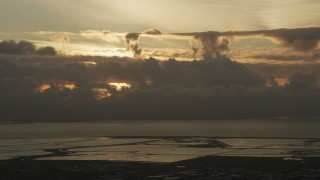 AF0001_001034 - Aerial stock footage of Cloud formations over the San Mateo Bridge in San Francisco Bay at sunset in California