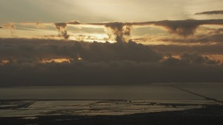 AF0001_001035 - Aerial stock footage of Cloud formations over San Francisco Bay and San Mateo Bridge at sunset in California