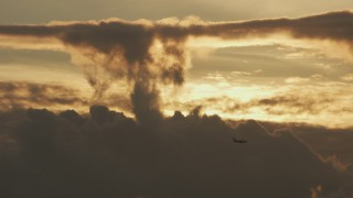AF0001_001036 - 8K stock footage aerial video track a passenger jet flying over the clouds at sunset in Northern California