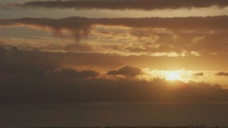 AF0001_001039 - 8K stock footage aerial video setting sun dipping behind clouds formations in Northern California