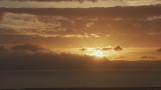 AF0001_001040 - Aerial stock footage of Setting sun and golden clouds formations in Northern California