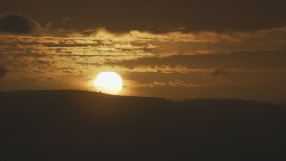 AF0001_001042 - Aerial stock footage of A commercial jet flying by the setting sun in Northern California
