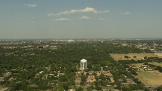 AI05_DAL_02 - 1080 stock footage aerial video flying over residential neighborhoods, approaching AT&T Stadium, Arlington, Texas