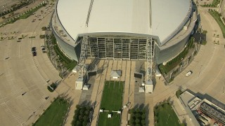 AI05_DAL_10 - 1080 stock footage aerial video tilt and pull back to view of the front of AT&T Stadium, Arlington, Texas