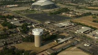 AI05_DAL_11 - 1080 stock footage aerial video orbit tower with team names, AT&T Stadium, Rangers Ballpark, Arlington, Texas