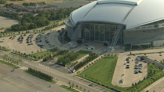 AI05_DAL_14 - 1080 stock footage aerial video zoom out from flags, revealing AT&T Stadium, Arlington, Texas