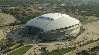 AI05_DAL_16 - 1080 stock footage aerial video orbiting AT&T Stadium, Arlington, Texas