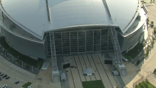 AI05_DAL_18 - 1080 stock footage aerial video flying by side of AT&T Stadium, pull back, orbit the stadium, Arlington, Texas