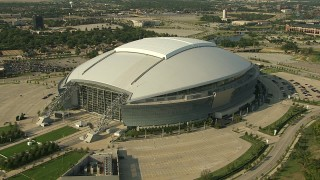 AI05_DAL_19 - 1080 stock footage aerial video approaching AT&T Stadium, near Rangers Ballpark, zoom in, Arlington, Texas