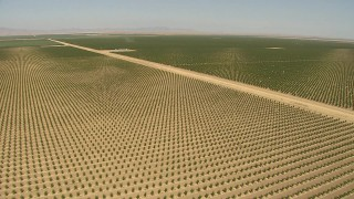 AI06_FRM_052 - 1080 stock footage aerial video fly over fields, crops, dry canals, manmade pond, Central Valley, California