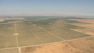 AI06_FRM_113 - 1080 stock footage aerial video farmland surrounding aqueduct, Central Valley, California