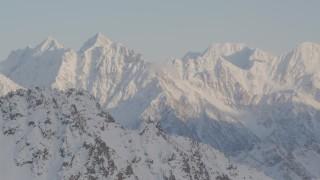 AK0001_0006 - 4K stock footage aerial video revealing snow covered Chugach Mountain peaks, Chugach National Forest, Alaska