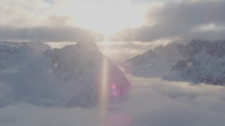 AK0001_0011 - 4K stock footage aerial video snow-covered peaks, clouds, Chugach Mountains, Chugach National Forest, Alaska