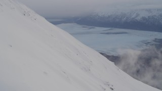 AK0001_0022 - 4K stock footage aerial video snowy slope, Knik Glacier, Inner Lake George, Chugach National Forest, Alaska