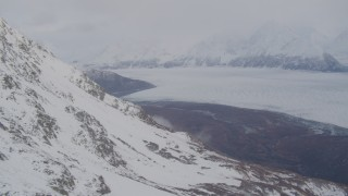 AK0001_0023 - 4K stock footage aerial video pan right by Knik Glacier and Chugach Mountains, Knik Glacier, Alaska