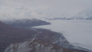 AK0001_0025 - 4K stock footage aerial video pan right by Knick Glacier, bordered by Chugach Mountains, Knik Glacier, Alaska