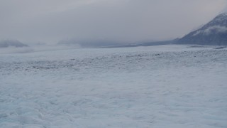 AK0001_0030 - 4K stock footage aerial video flying low over surface of the Knik Glacier, Alaska