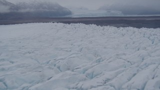AK0001_0034 - 4K stock footage aerial video flying low over Knik Glacier, approach end of glacier, Knik Glacier, Alaska