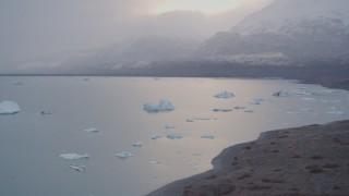 AK0001_0039 - 4K stock footage aerial video flying low along edge of Inner Lake George, Alaska