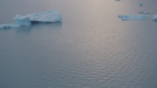 AK0001_0042 - 4K stock footage aerial video flying low over the lake surface, approaching icebergs, Inner Lake George, Alaska