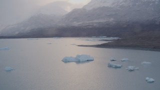 AK0001_0043 - 4K stock footage aerial video flying over icebergs, approach snow covered mountains, Inner Lake George, Alaska