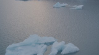 AK0001_0045 - 4K stock footage aerial video fly over icebergs, reveal lake, snow covered mountains, Inner Lake George, Alaska